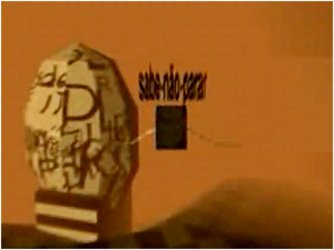 "Screen capture of ""Palavrador"" by Chico Marinho. Terracotta background with a giant stone on it. The stone has random letters engraved on it and text appears above a square, to the left of the stone."