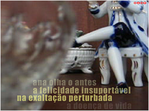 "Screen capture from ""Amor de Clarice"" by Rui Torres. Close-up shot from a table with a porcelain figure of a man sitting down. Text: ""ana olha o antes a felicidade insuportavel na exaltaco perturbada""."""