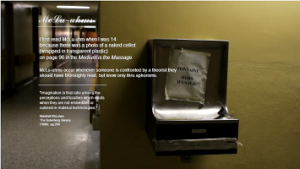 "Screen capture of ""McLu-uhms"" by David Jhave Johnston. An out-of-service drinking fountain. Text: ""(too small to read)"""