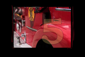"Screen capture from ""Figure 5 Media Series,"" by William Carlos Williams, Charles Demuth, and Megan Sapnar. Photograph of a fire engine overlain with a transparent number 5."