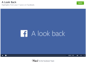 "Screen Capture from ""A Look Back"" by Mark Zuckerberg and the Facebook Team. A video player with a centered text in white with the Facebook Logo. Text: ""A Look Back""."